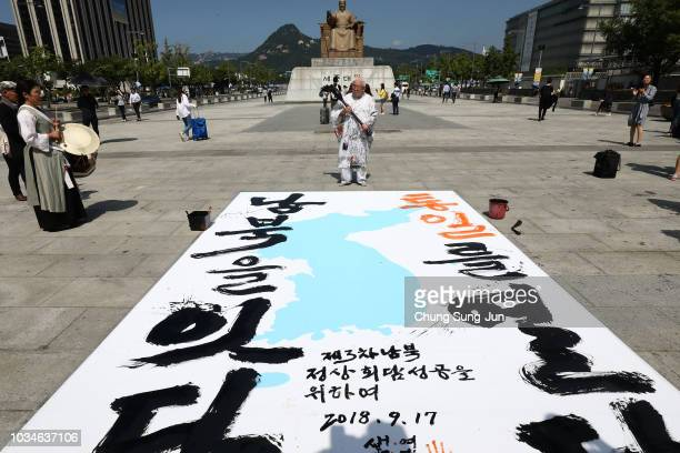 South Korean calligraphist Yeo Taemyong writes calligraphy on the unification flag to celebrate the upcoming interKorean summit on September 17 2018...