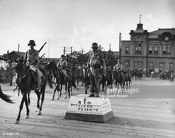 South Korean cavalry soldiers sit on their horses outside Taegu Station waiting to be transported to the front | Location Taegu Station Taegu Korea