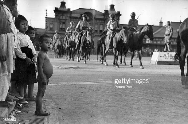 South Korean Cavalry troops forming up in a street in Taegu before being transported to the front Original Publication Picture Post 5086 We Follow...