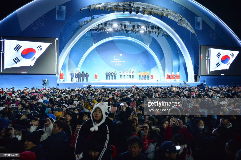 South Korean celebrate south korea's gold medal during the medal ceremony for the Ladies Short Track Speed Skating 3000m Relay on day twelve of the PyeongChang 2018 Winter Olympic Games at Medal Plaza.February 21, 2018 . February 21, 2018