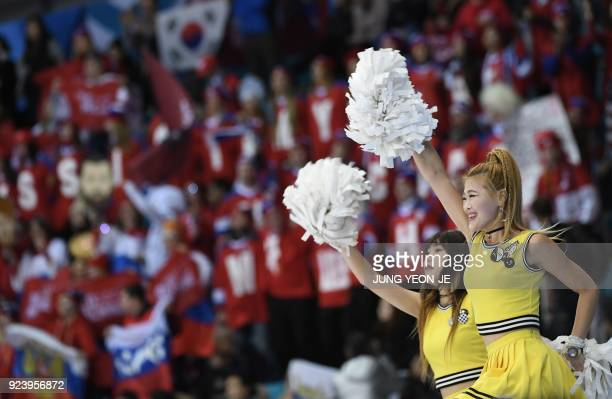 South Korean cheerleaders perform in the men's gold medal ice hockey match between the Olympic Athletes from Russia and Germany during the...