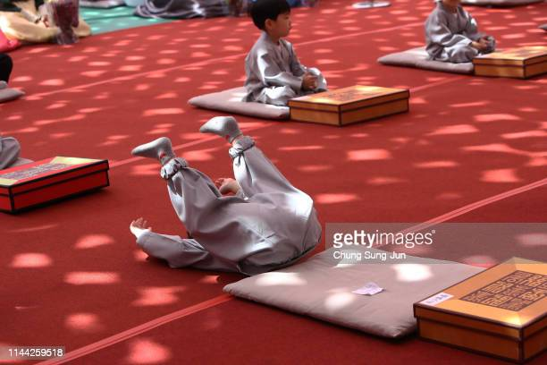 South Korean child monks pray during the 'Children Becoming Buddhist Monks' ceremony forthcoming buddha's birthday at a Jogye temple on April 22 2019...