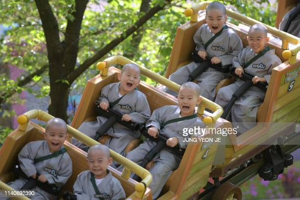 South Korean children monks ride a roller coaster as they visit an amusement and animal park during their training program learning about Buddhism in...