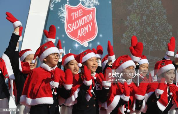 South Korean children wearing Santa Claus outfits perform during a ceremony to launch a yearend fundraising campaign of the Salvation Army at...