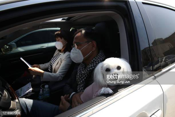 South Korean Christians from the Seoul City Church gather worship from their car at a drivein worship service as South Koreans take measures to...