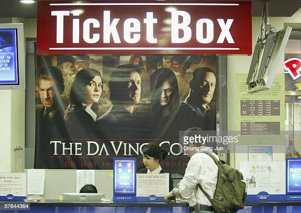 South Korean cinemagoer purchases tickets for The Da Vinci Code on May 18 2006 in Seoul South Korea The film starring Tom Hanks and Audrey Tautou...
