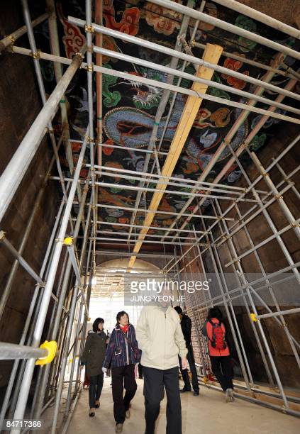 South Korean citizens look around the Namdaemun a 600yearold gate listed at the country's number one national treasure in Seoul on February 10 2009...