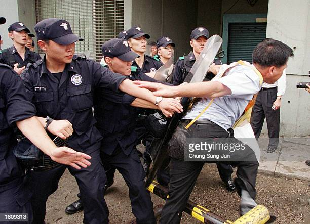 South Korean civic group leader Park Chansung scuffles with riot police near the Japanese Embassy August 15 2001 in Seoul AntiJapanese protesters...