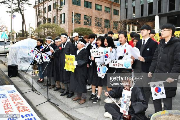 South Korean civic group members stage a rally in front of the Japanese Embassy in Seoul on Feb 22 protesting against the designation of the day by...