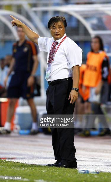 South Korean coach Choi Duck Joo gives instructions to his players during the FIFA Women's Under17 semifinal match against Spain on September 21 at...