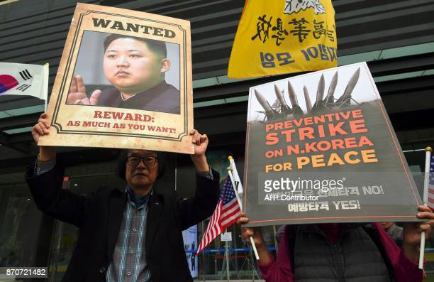 South Korean conservative activists hold placards showing a picture of North Korean leader Kim JongUn during a proUS rally near the US embassy in...