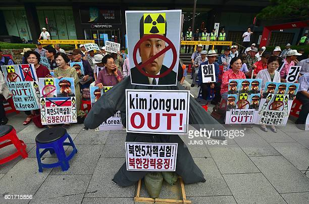 South Korean conservative activists set an effigy of North Korean leader Kim Jong-Un during a protest denouncing North Korea's nuclear test in Seoul...