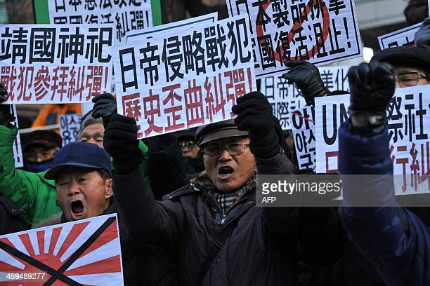 South Korean conservative activists shout slogans during a protest to lodge a complaint against Japanese Prime Minister Shinzo Abe visiting the...