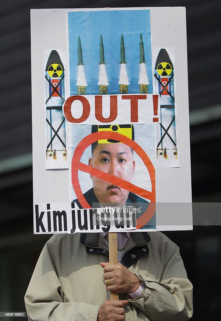 A South Korean conservative protester holds placard during a anti-North Korea rally on March 26, 2014 in Seoul, South Korea. North Korea test-launched two Nodong medium-range ballistic missiles into the sea off Korean peninsula's east coast on Wednesday morning, according to South Korea's defence ministry.