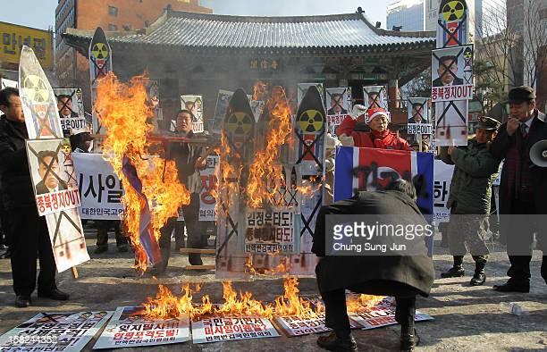 South Korean conservative protesters burn a mockup of a North Korean missile and portraits of North Korean leader Kim JongUn during an antiNorth...