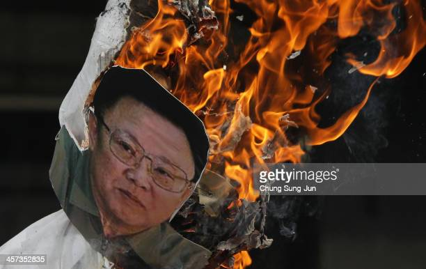 South Korean conservative protesters burn an effigy of former North Korean leader Kim JongIl during an antiNorth Korea protest marking the second...