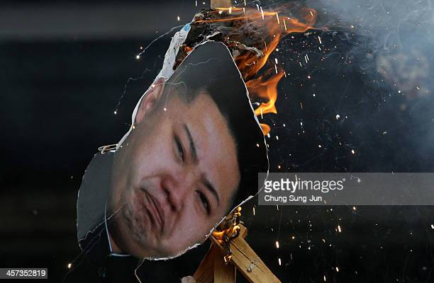 South Korean conservative protesters burn an effigy of North Korean leader Kim Jong-Un during an anti-North Korea protest marking the second...