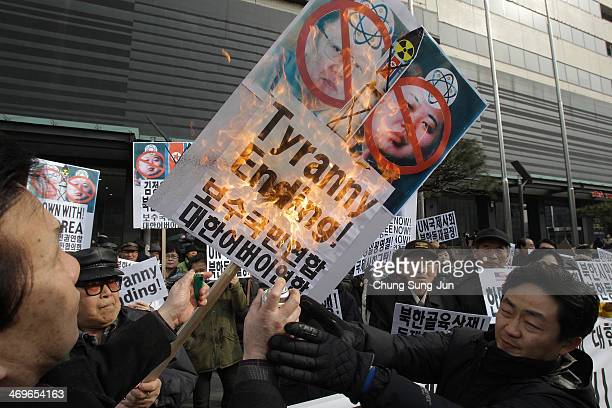 South Korean conservative protesters burn antiNorth Korea placards during a anti North Korea protest marking the former North Korean leader Kim...
