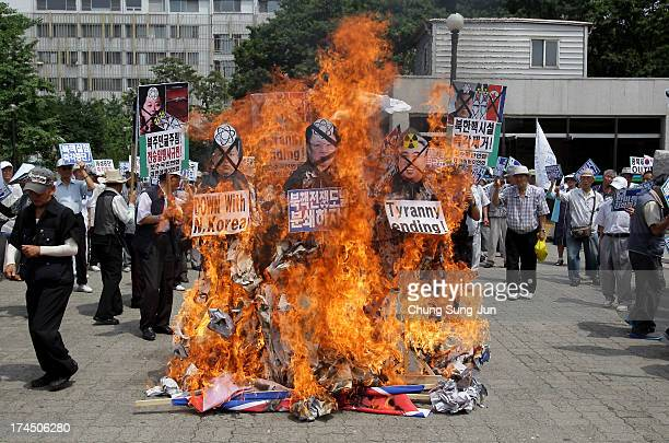South Korean conservative protesters burn effigies of North Korea national founder Kim IlSung former North Korean leader Kim JongIl and now leader...