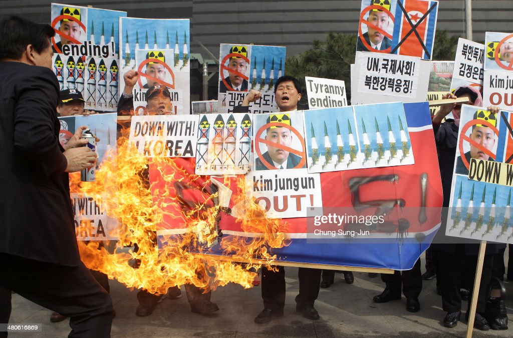 South Korean conservative protesters burn North Korea's flag during a anti-North Korea rally on March 26, 2014 in Seoul, South Korea. North Korea test-launched two Nodong medium-range ballistic missiles into the sea off Korean peninsula's east coast on Wednesday morning, according to South Korea's defence ministry.