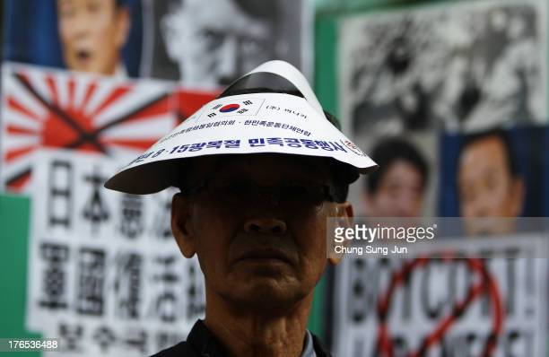 South Korean conservative protesters participate in antiJapan demonstrations as South Korea marks the 68th Independence Day in front of the Japanese...
