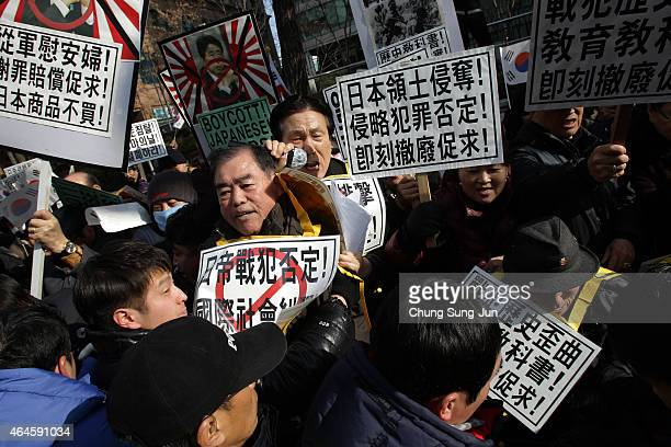 South Korean conservative protesters scuffle with police during a demonstration as South Korea marks the forthcoming 96th Independence Movement Day...