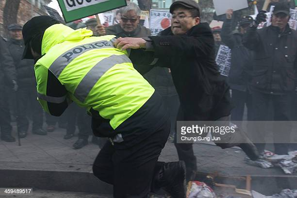 South Korean conservative protesters scuffle with police during a antiJapan rally in front of the Japanese embassy on December 27 2013 in Seoul South...