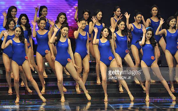 South Korean contestants perform during the 2013 Miss Korea beauty contest in Seoul on June 4 2013 The 21yearold student Yoo YeBin beat 54 other...