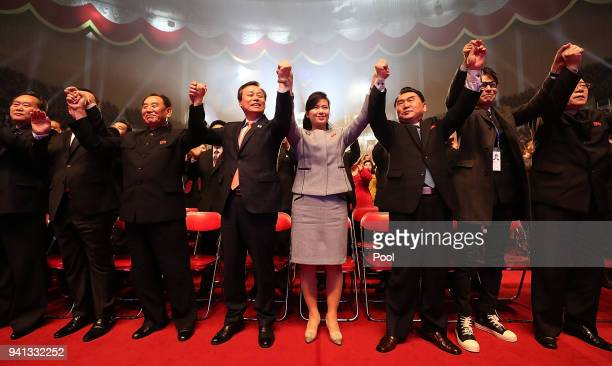 South Korean Culture Sports and Tourism Minister Do JongWhan Hyon Songwol head of the North Korea's Samjiyon Orchestra and Kim Yong Chol vice...