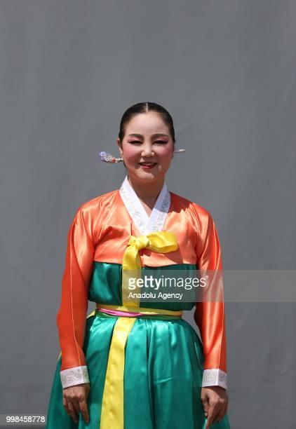 South Korean dancer Lee Sun Deuk poses for a photo during the International Golden Karagoz Folk Dance Competition within the International Bursa...