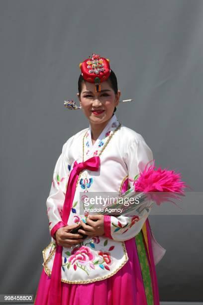 South Korean dancer Yun Hyon Su poses for a photo during the International Golden Karagoz Folk Dance Competition within the International Bursa...