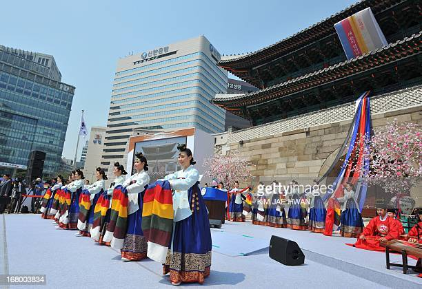 South Korean dancers perfom during the reopening ceremony of Namdaemun gate in Seoul on May 4 2013 South Korea on May 4 reopened its landmark...