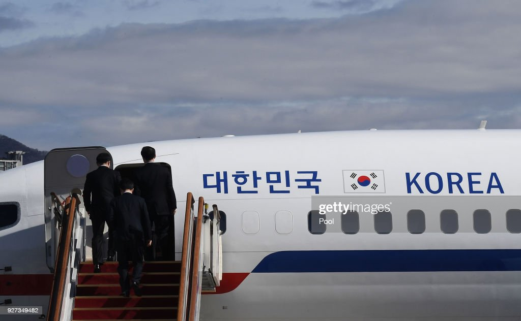 A South Korean delegation boards an aircraft as they leave for Pyongyang at a military airport on March 5, 2018 in Seongnam, South Korea. South Korean envoys are to visit North Korea for two days to discuss issues.