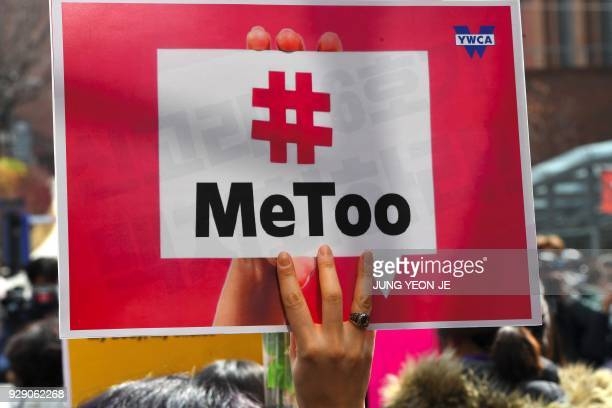 A South Korean demonstrator holds a banner during a rally to mark International Women's Day as part of the country's #MeToo movement in Seoul on...
