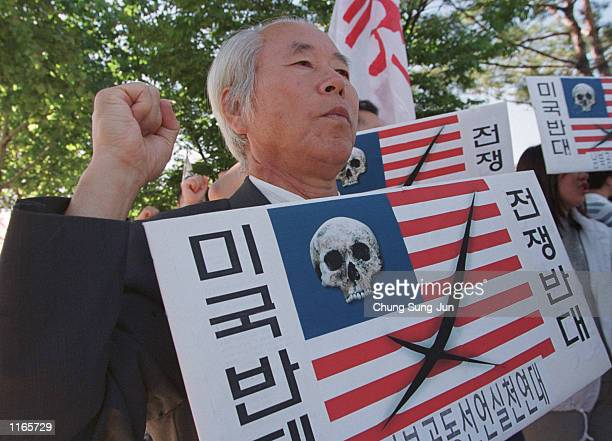 South Korean demonstrators hold altered American flag placards during an antiAmerican protest September 22 2001 near the Yongsan US Army Base in...