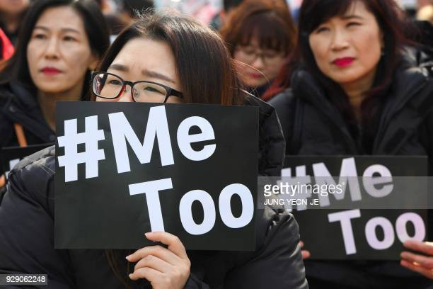 TOPSHOT South Korean demonstrators hold banners during a rally to mark International Women's Day as part of the country's #MeToo movement in Seoul on...