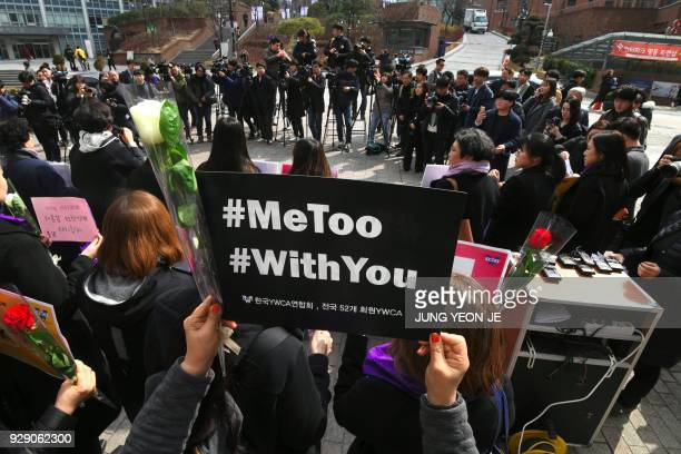 South Korean demonstrators hold banners during a rally to mark International Women's Day as part of the country's #MeToo movement in Seoul on March 8...