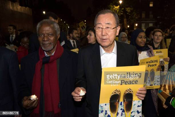 South Korean diplomat Ban Kimoon and Ghanian diplomat Kofi Annan both former SecretaryGenerals of the United Nations lead a procession to Parliament...