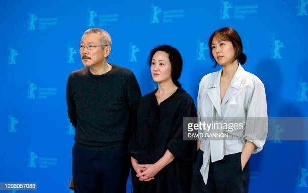 South Korean director and screenwriter Hong Sangsoo and South Korean actresses Seo Younghwa and Kim Minhee pose during a photocall for the film...