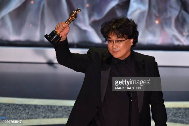 TOPSHOT South Korean director Bong Joonho accepts the award for Best International Feature Film for Parasite during the 92nd Oscars at the Dolby...
