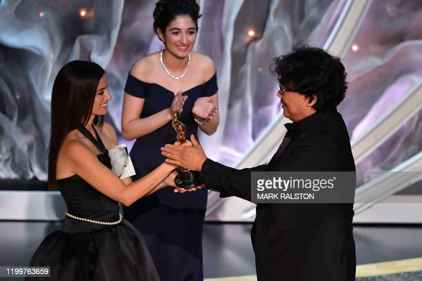 South Korean director Bong Joonho accepts the award for Best International Feature Film for Parasite from Spanish actress Penelope Cruz during the...