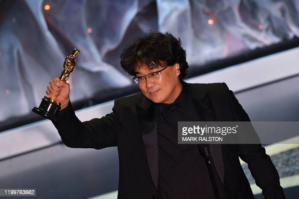 "South Korean director Bong Joon-ho accepts the award for Best International Feature Film for ""Parasite"" during the 92nd Oscars at the Dolby Theatre..."