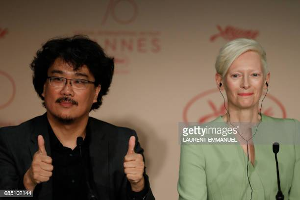 South Korean director Bong Joonho and British actress Tilda Swinton attend on May 19 2017 a press conference for the film 'Okja' at the 70th edition...