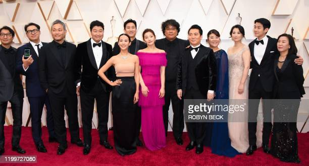 South Korean director Bong Joonho arrives with the cast and crew of Parasite for the 92nd Oscars at the Dolby Theatre in Hollywood California on...