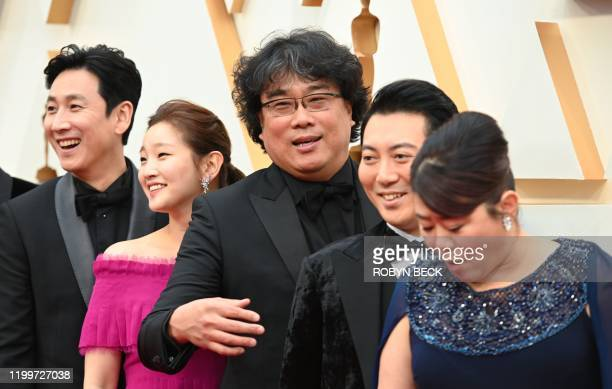 South Korean director Bong Joonho arrives with the cast of Parasite for the 92nd Oscars at the Dolby Theatre in Hollywood California on February 9...