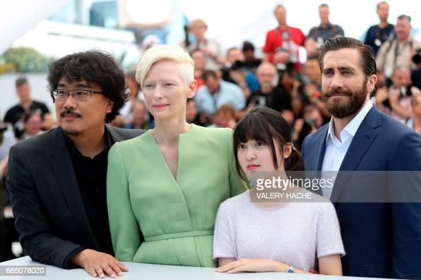 South Korean director Bong Joonho British actress Tilda Swinton South Korean actress Ahn Seohyun and US actor Jake Gyllenhaal pose on May 19 2017...