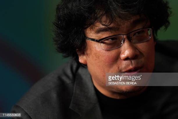 South Korean director Bong JoonHo leaves after holding a press conference for the film Parasite at the 72nd edition of the Cannes Film Festival in...