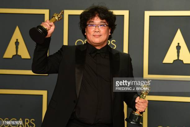 South Korean director Bong Joonho poses in the press room with the Oscars for Parasite during the 92nd Oscars at the Dolby Theater in Hollywood...