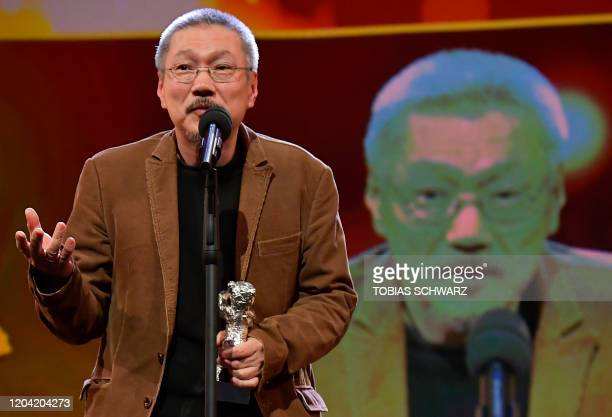 South Korean director Hong Sangsoo speaks after receiving the Silver Bear for Best Director during the awarding ceremony of the 70th Berlinale film...