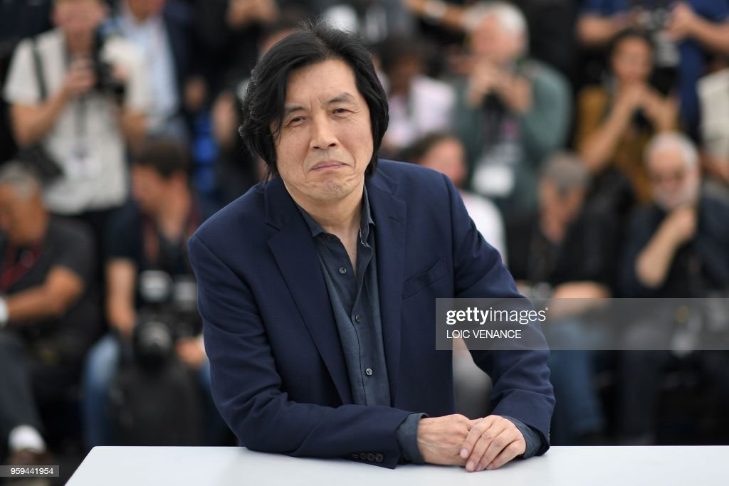 South Korean director Lee Chang-Dong poses on May 17, 2018 during a photocall for the film 'Burning' at the 71st edition of the Cannes Film Festival in Cannes, southern France.